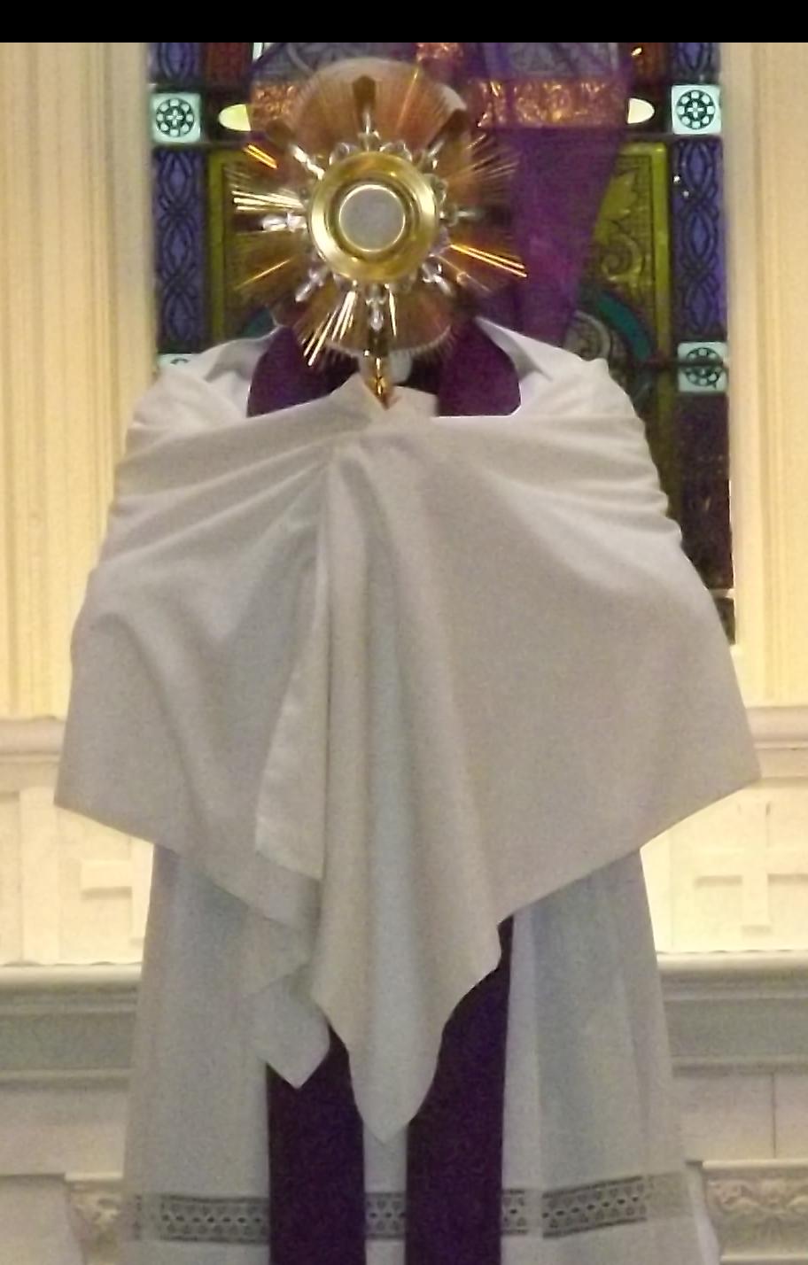 priest holding monstrance