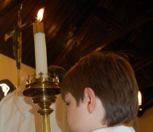 Acolyte holding candle